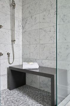 FREESTANDING BENCH, OPEN BELOW!Contemporary bathroom shower is filled with white grid marble tiles lined with a freestanding gray quartz waterfall shower bench placed atop a gray hex shower floor. Bad Inspiration, Bathroom Inspiration, Bad Bank, Bathroom Bench, Master Bathroom, Bathroom Ideas, Bathroom Showers, Bathroom Cabinets, Restroom Cabinets