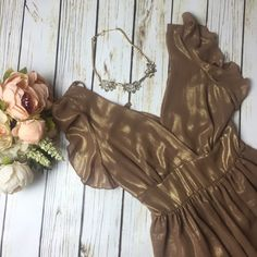 ✨NWOT✨ LF Gold Dress with Flutter Sleeves A gold dress with a v-neck. Ruffled sleeves. Tie waist. And a tie at the back of the neck. Very elegant. Never worn. Great for date night or a night out with friends. Made by Love. 100% Polyester.  ❌ Trades 💯 Authentic  ❌ PayPal 💞 Discounts on Bundles  ✅ Offers Welcome  🙋🏼 Yes to Questions LF Dresses Midi