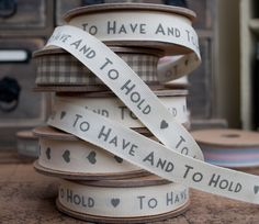East of India ivory ribbon with 'To have and to hold' wording