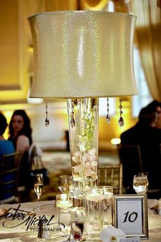 47bb9f4cb7c A glistening gold lampshade creates dramatic flare at Drexelbrook.  Centerpiece Decorations