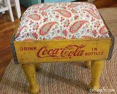 Footstool Using an Old Soda Crate - great use of a vintage crate and the fabric choice  is just too cute. #DIY  [now all I have to do is wrestle an old Coke crate out of my mother's hands....Pigs will likely be flying outside.]