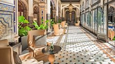 The colonnaded gallery surrounding the central patio is a serene oasis and the…