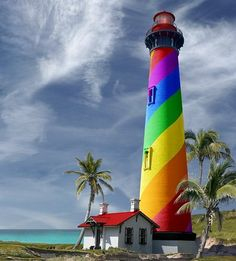 Rainbow Lighthouse- I would love a light like this! photoshopped by Mike Jones Photos- The lighthouse is St Augustine Lighthouse in Florida. The foreground, background, sky, and palm trees are from various different places. Love Rainbow, Taste The Rainbow, Over The Rainbow, Rainbow Colors, Rainbow Light, Rainbow Swirl, Bright Colors, St Augustine Lighthouse, Beacon Of Light