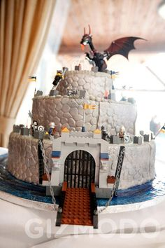 Castle cake with lego theme. Such a great idea, fondant covered cake to look like stone and rest is real legos.