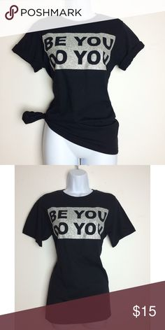 """👀Black & Silver Be You Do You Graphic Tee👀 Super cute nice fit & you can wear it 3 different ways! L💜VE it! 100% Cotton """"Be You"""" meaning -Be genuine don't compare yourself to other people.  Don't worry about what people think. Don't let people push you in a direction if you don't agree. Be the person you were created to be. Don't do things you don't want to do. """"Do You"""" means just that! Live life to the fullest. Do what YOU love and what makes YOU happy! Do what's in your best interest…"""