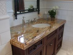 Captivating Brown / Tan /White Granite Vanity With Oval Undermount Sink And Dark  Colored Cabinets |