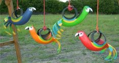 Tropical Tire Swings - Jeff Lehman's business, Recycled Creations, turns old tires into colorful tropical bird planters, recycled tire horse swings, standing tire p...