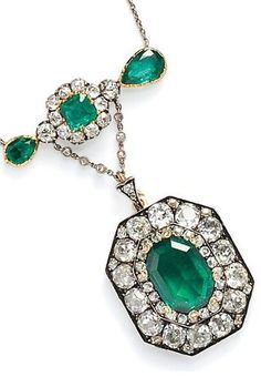Antique Emerald and Diamond Pendant, centering an emerald-cut emerald measuring approx. 15.55 x 11.20 x 3.92 mm, and weighing approx. 3.50 cts., framed by old mine-cut diamonds, approx. total diamond wt. 7.00 cts., and suspended from a bar set with emerald- and pear-shape emeralds and old mine-cut diamonds, silver-topped gold mount, and suspended from trace link chain.