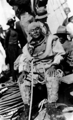 A Japanese pearl diver on a pearl lugger at Thursday Island, Torres Strait, Queensland, Australia. He is wearing a diving suit, without the helmet. Undated photo. From the collection of the State Library of Queensland.