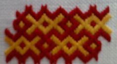 Here's pattern #15!  I really like this one.  I think that you could use it fairly neatly as a border as well.  The interlocking red is stit...