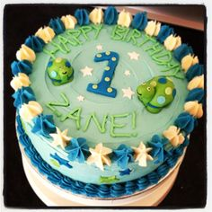 1st birthday cake, with a blue, green and white tortoise and star theme as a brief. Vanilla sponge and buttercream.