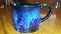 """PC 2X obsidian. Then a 3/4"""" ring of seaweed at the top, 3/4"""" ring of Indigo Float below that, and finally 3/4"""" ring of Blue Rutile below that. Glaze covered about 1/2 of the mug"""