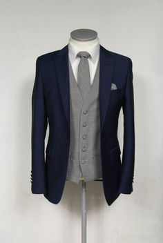 Royal blue slim fit suit with grey and sky prince of wales single breasted waistcoat and tie complete outfit to hire £159.50 wedding suits for grooms to hire or purchase. www.anthonyformal... #wedding #groom #suit #anthonyformalwear #suithire #navy