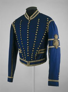 Coachman's jacket - Russia 1881–1917. Thousands of gold and silver buttons adorned the dress worn at the Russian court. This late 19th-century coachman's jacket, part of everyday winter uniform, bears 99 plain gold buttons. The buttons on the more formal versions of coachmen's livery are usually stamped with royal insignia.