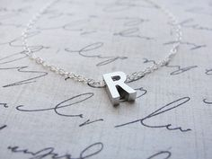 "With a ""M"" of course!! Waaaant!    Tiny silver letter necklace  Silver initial by OliveYewJewels, $28.00"