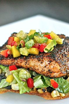 Chili-Rubbed Salmon with Mango Avocado Salsa a delicious meal that is perfect for entertaining! Recipe from The Hopeless Housewife