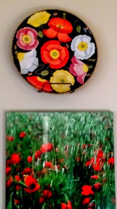 Poppy plate with poppy photograph: ceramic plate depicting Icelandic poppies on a black ground painted by artist Geoff Graham of Cinnabar Ceramics in Vallejo, California