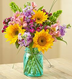 Pretty sunflowers in a blue mason jar.. How sweet is this for Spring?