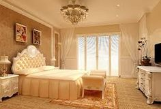 Creamy vanilla color palette, white and beige bedroom- notice the curtains pulled to the edges of the room? Drawing your eye to the high ceiling, without obstructing light from french doors.
