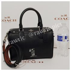 "New Coach peanuts snoopy black leather satchel 100% authentic limited edition Coach peanuts mini Bennett. Crossgrain black leather with silver tone hardware and protective metal feet. Zip top closure and fabric lining. Inside zip and slip pockets. Handles drop 4"". Longer detachable and adjustable strap. Measures 9"" (L) x 6.5"" (H) x 4.5"" (W). Brand new with tags. Comes from a pet and smoke free home. Coach Bags Crossbody Bags"