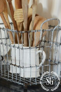 FARMHOUSE STYLE ~ Wire baskets remind me of the gathering baskets farmers used to collect eggs! But we don't have to have the real thing to make a farmhouse statement. Instead of eggs my basket holds vintage ironstone pitchers and wooden spoons! Don't you love the rustic finish on the basket?