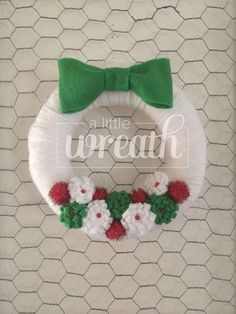 Christmas Yarn Wreath, Retro Wreath, White Wreath, White Yarn Wreath, Red and Green Wreath, Yarn Wreath, Pompom Wreath by alittlewreath on Etsy https://www.etsy.com/listing/250680542/christmas-yarn-wreath-retro-wreath-white