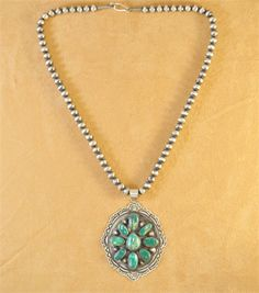 Handmade necklace pendant, with natural gem grade Stone Mountain Turquoise, by Navajo artist Donovan Cadman.