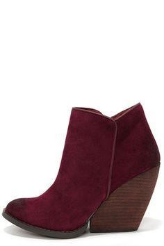 """With so many reasons to love the Very Volatile Whitby Wine Suede Leather Wedge Booties, we can hardly keep our """"whits"""" about us! Genuine suede leather makes a sumptuous overlapping upper with a bit of oil-rubbing along the almond toe and heel, plus a curvy collar (with 10.5"""" circumference). 3.75"""" stacked wood almost-wedge heel adds a dose of brown to this pretty palette. Cushioned insole. Nonskid rubber sole. Available in whole and half sizes. Measurements are for a size 6. Leather upper…"""