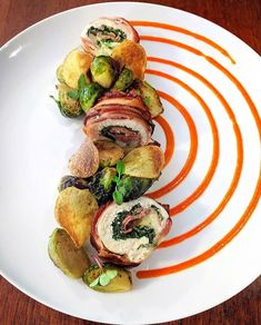 TBT - bacon wrapped chicken roulade stuffed with provolone, prosciutto and spinach, crispy Yukon chips, brussel sprouts and red bell pepper… Chicken Roulade Recipe, Gourmet Food Plating, Food Plating Techniques, Gourmet Recipes, Cooking Recipes, Bacon Wrapped Chicken, Chicken Prosciutto, Food Decoration, Restaurant Recipes