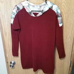Long sleeve, long torso shirt. Maroon solid color, shoulders and hood are sequins pattern. Sequins is not lined. Just long enough to cover backside, perfect for leggings or skinny jeans! Style Rack  Tops Tunics