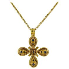 Ilias Lalaounis Enamel Gemstone Gold Maltese Cross Pendant Necklace  | From a unique collection of vintage necklace enhancers at https://www.1stdibs.com/jewelry/necklaces/necklace-enhancers/