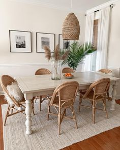 The clean simplicity of Scandinavian design meets the airy look of an open-weave pendant. Beautifully woven from rattan, it adds the perfect dose of artistry and texture to the room. Rattan Dining Chairs, Bistro Chairs, Wooden Dining Tables, Dining Room Table, Dining Room Rugs, Dining Room Area Rug Ideas, Coastal Dining Rooms, Farmhouse Dining Room Rug, White Dining Chairs
