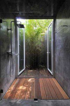 Concrete shower, with teak floor and doors to the outside. Just imagine showering there with the doors open and snow outside.