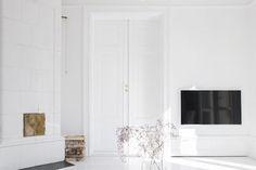 A vast white Swedish kakelugn (masonry oven) in the dreamy home of Sara Medina Lind