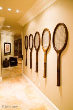 Repurposed old tennis rackets used as wall art. High Camp Home Interior Design