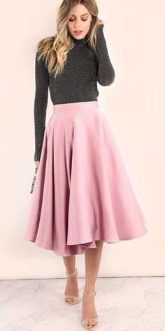 Midi Tulle Circle Skirt BLUSH.  The Midi Tulle Circle Skirt will make you blush with its' ultimate charm! Features a tulle lining for a voluminous body, pleated design and an elastic waistband. Pair with a backless turtleneck knit top and barely heels for a sweet ensemble perfect for an afternoon tea party!