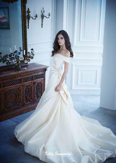 Classic wedding dress. Bodice with off-the-shoulder neckline. Gemstone…