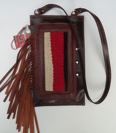 Small shoulder bag with decorative leather fringe and inlaid Navajo rug fragment. For more hand made bags and purses go to www.pccohandbags.com