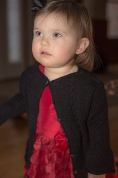 Ravenette is worked in fingering weight yarn and features a ruffle at cuff and hem and cable accents.