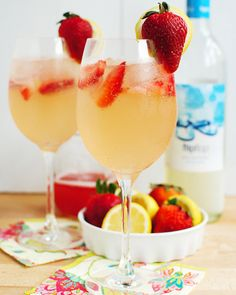 Strawberry Lemonade Spritzers-Strawberry simple syrup, lemon juice and Moscato wine combine to create this grown-up lemonade. It's great on a hot summer's day.