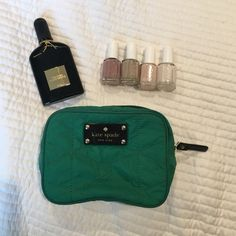 Used Kate spade green bow cosmetics case/zip pouch Gently used. Zipper works great. Some minor marks on back and inside from foundation. Would certainly come out if washed.  Will accept offers for trades or offers. Thanks! kate spade Bags Cosmetic Bags & Cases