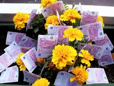Cool picture about free money that is growing on yellow flowers. This picture was made for my green friend epsos.de and is free to use for everybody.    The accounts of the money in this picture are from Europe and there are called Euros. The Euro is t