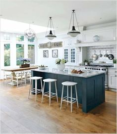 Popular small kitchen island concepts include shelves for cookbooks, shelfs for wine bottles, drop-leafs or pull-out cabinets for extra counter top area, as well as a kitchen counter overhang supplying breakfast bar-type seating for two. Kitchen Island Ideas On A Budget, Pictures Of Kitchen Islands, Kitchen Island Decor, Kitchen Island With Seating, Farmhouse Kitchen Cabinets, Modern Farmhouse Kitchens, Kitchen Pictures, Kitchen Ideas, Painted Kitchen Island