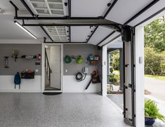 The professionally installed polyaspartic coating on the garage floor looks like epoxy but is far more durable. Garage Storage Bins, Overhead Garage Storage, Garage Storage Solutions, Built In Storage, Garage Organization, Organization Ideas, Small Garage, Double Garage, Garage Walls