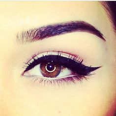 Liquid liner, brown eyes, perfect brow arch,  classy make-up