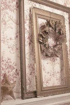 love this - just empty frames leaning on a ledge or mantle, even hanging on a wall empty - old ornate frames with lots of chippy gesso are art all on their own