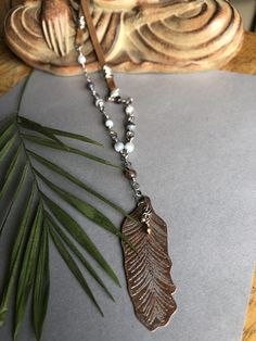 Hand sawn and stamped then etched feather hand wrapped botswana agate and leather Copper Sheets, Hand Saw, Water Pearls, Feather Design, Cool Necklaces, Sale Items, Fresh Water, Hand Stamped, Tassel Necklace