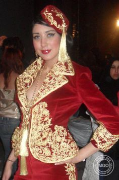 Algerian woman in traditional Clothes.Karako , and Chachia  on her Head