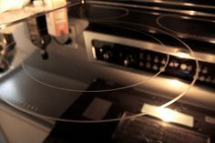 Glass cooktop cleaner: soak a dish rag in hot soapy water, sprinkle baking soda on surface, wring out about half the water in the rag and let sit on the baking soda for 15 min, using gentle circular motions clean the cooktop. Repeat if necessary. Can shine up with Windex.