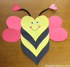 These little heart shaped bumblebee crafts are super easy to make, take hardly any time at all, and will even help your child practice their scissor skills (if they're old enough for scissors that is).  Oh, and did I mention that they are adorable?